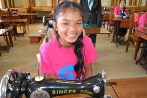 Your gift is helping Van learn to sew!