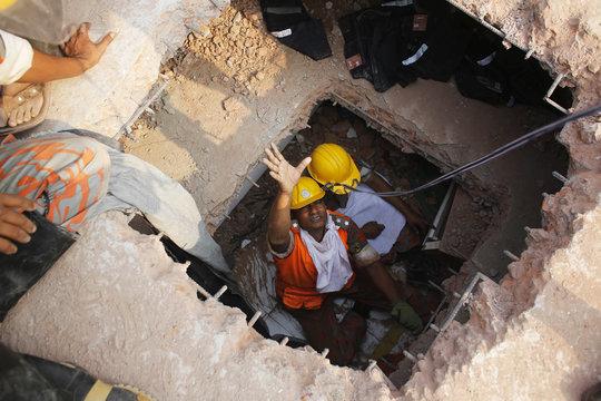 Rescuers working beneath layers of fallen floors