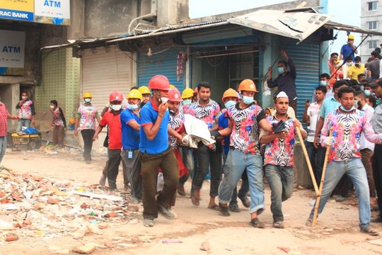 First responders rush a survivor from the ruins