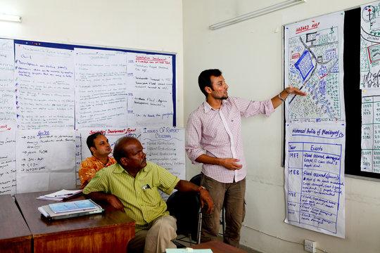 Presenting group work. Copyright RedR/GMB Akash