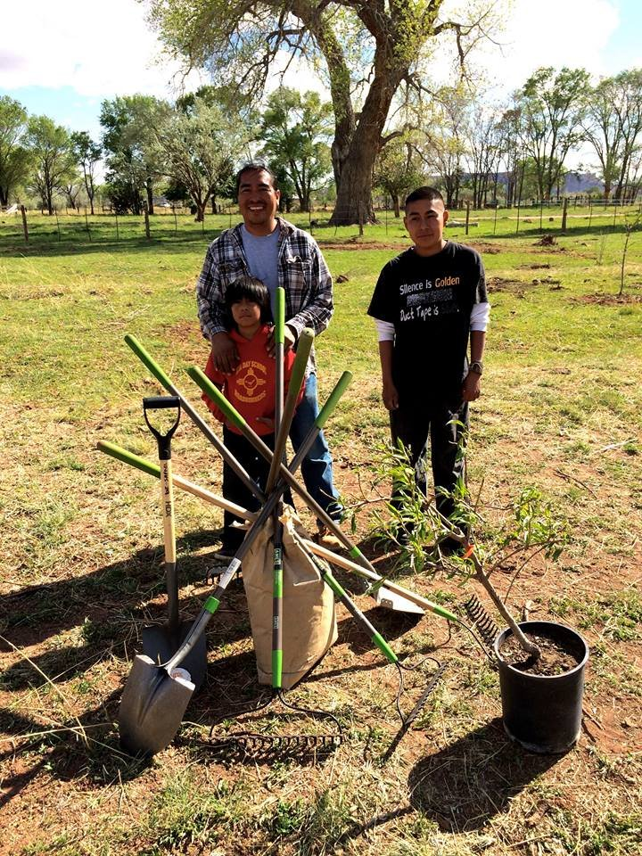 A family receives their fruit trees in New Mexico
