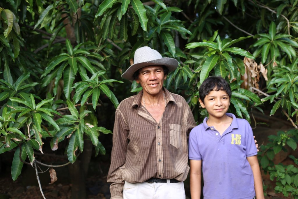 Father & Son in front of their growing mango trees
