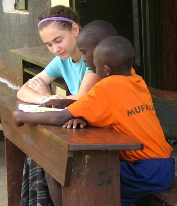 Grace, on a Teen Service Trip, reads with a child