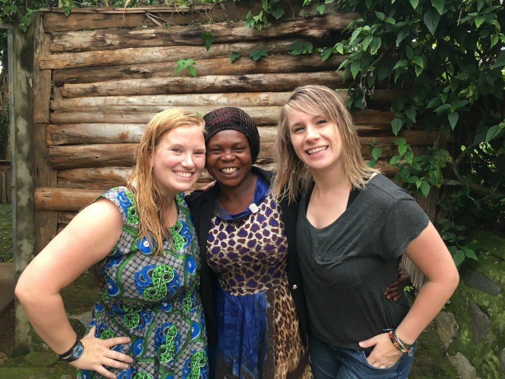 Jennipher (center) with two visitors in Uganda