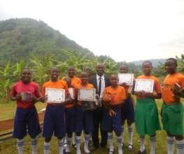Bukiga Primary School students & coach