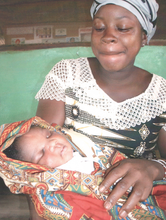 A mom & her healthy baby at the Imani House clinic