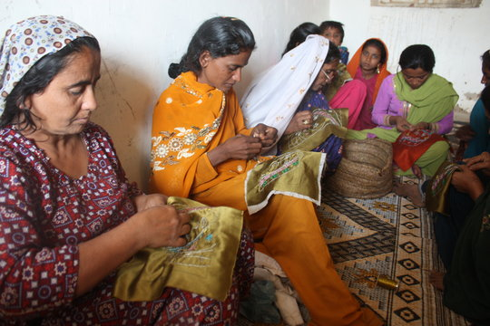 Sughar Women learning embroidery skills in Center