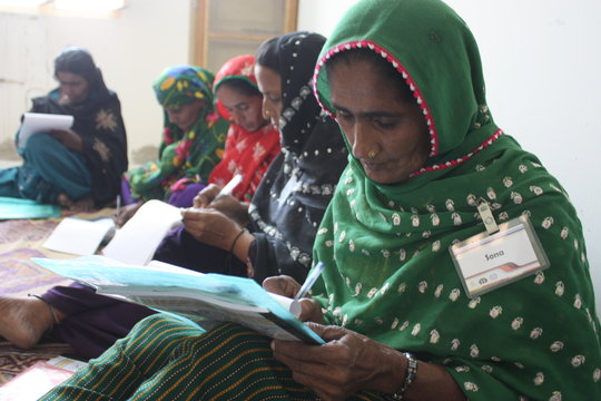 In the Sughar Center women learning to write