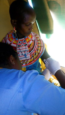 Nalimu as she receives her implant