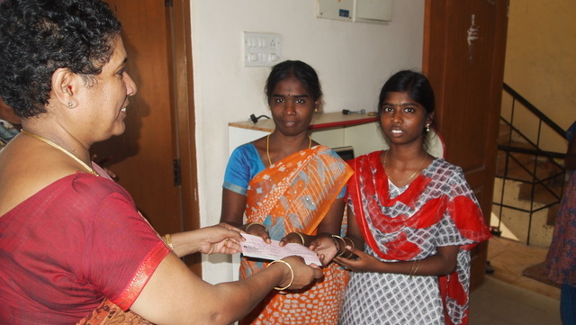 Scholarship Cheque is given to Ms.Divya, Her mothe