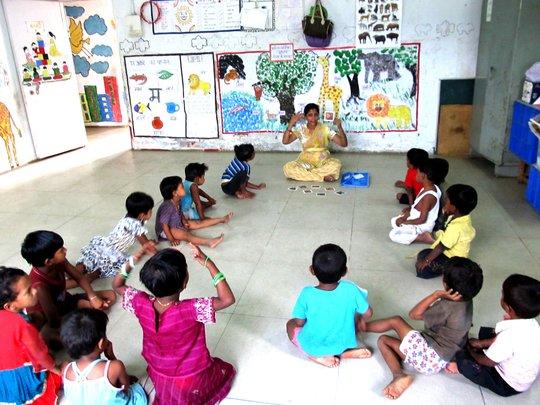 Pre primary children listening attentively