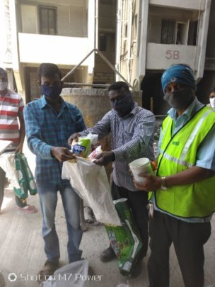 Our builder distributing dry ration to workers