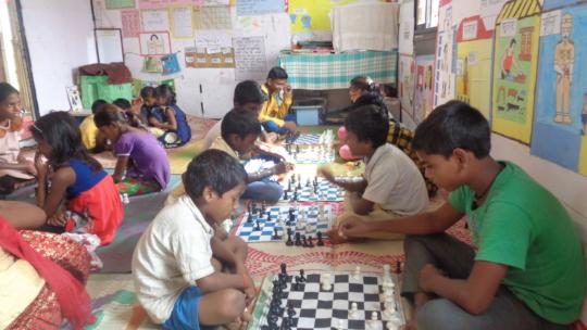Check and Mate! Children enjoying chess !