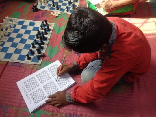 Child engrossed in learning the techniques of play