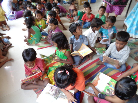 Our little readers busy reading their books