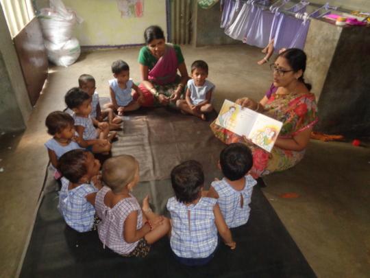 Teacher sharing stories to creche children