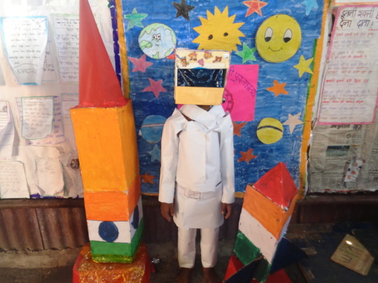 Primary children created space suite out of scrap