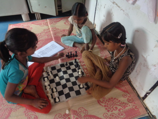 Girls from our centre practicing chess