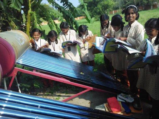 Students learn near the solar plant - 1