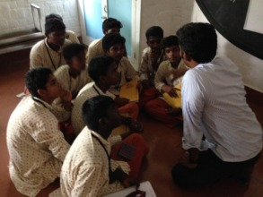 Suresh interacts with a group of students