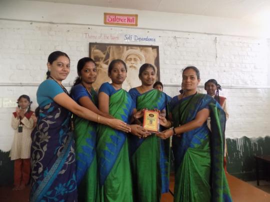 Teachers with the school award