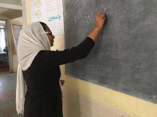 Salma working out an algebra problem
