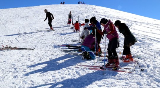 Shukria and her classmates skiing in Bamyan