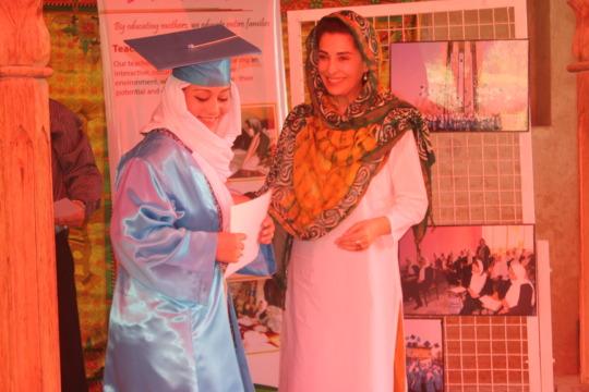 Hassina Sherjan awarding diplomas