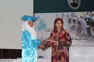 Hassina Sherjan giving diplomas