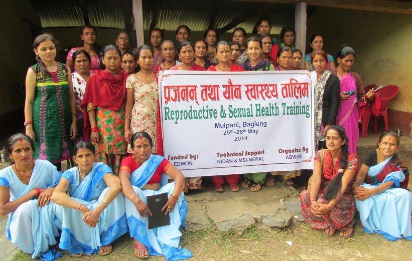 Saraswati (in green, behind sign) w/ Baglung group