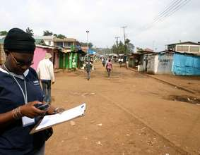 Millicent Achieng gathers map data using GPS