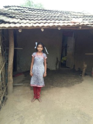 Girls infront of her homes