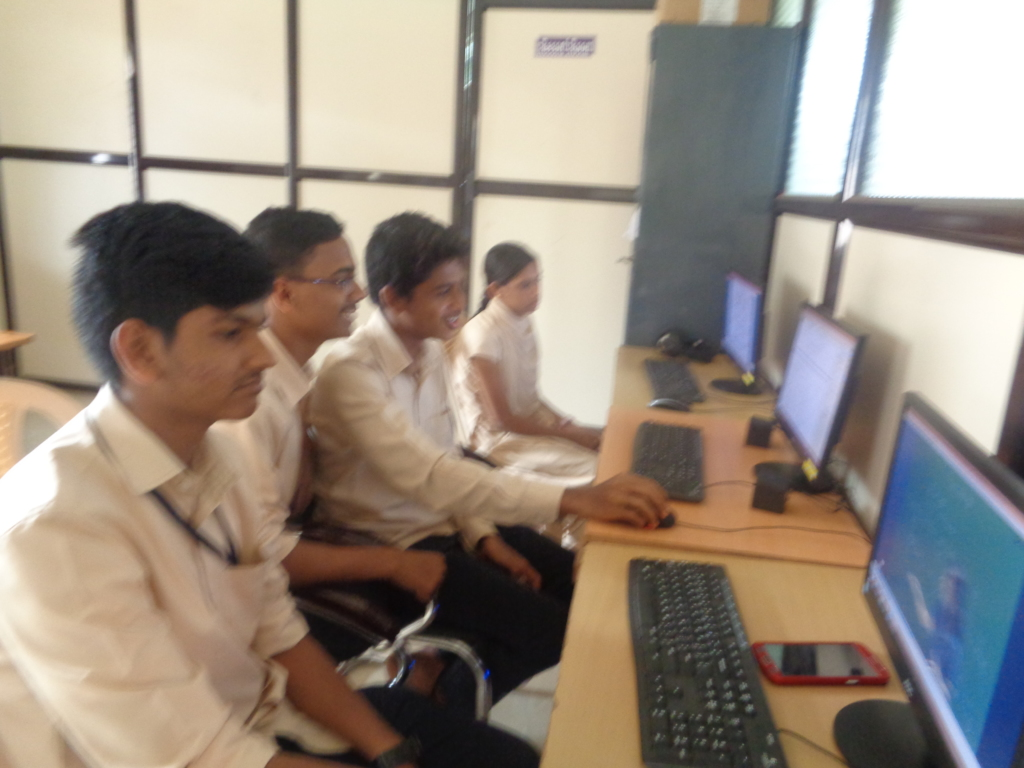 Students using computer in learning center