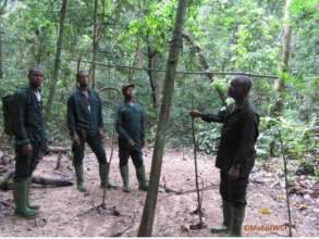 Anti-poaching team discovering a poacher camp