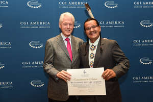 Henry Red Cloud with President Clinton at CGI