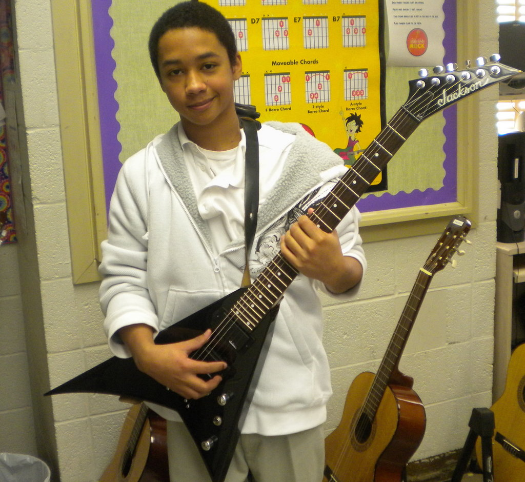 LKR student with the new guitar he won.