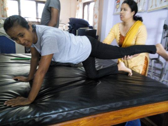 Physiotherapist teaching Physio