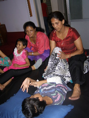 Mothers providing physio with new therapist