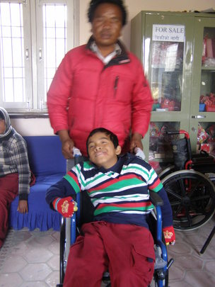 wheel chair distribution to needy children