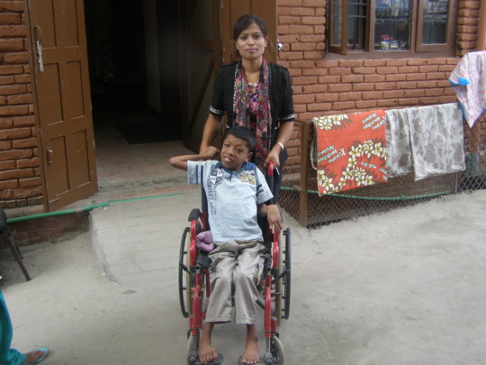 Wheel Chair to Prabu with his mother