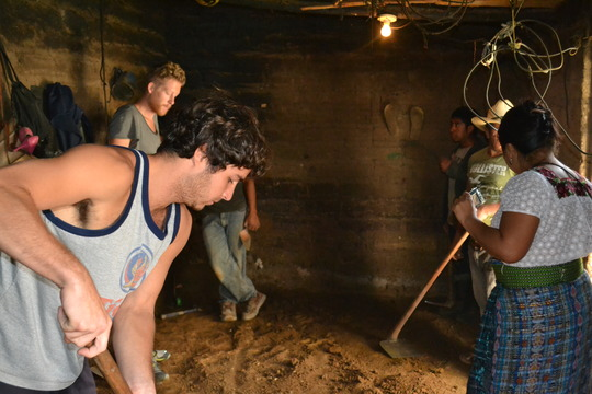 volunteers help with a floor pour