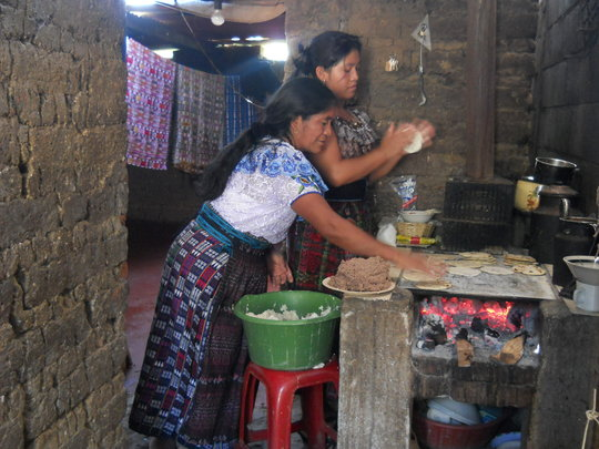 making tortillas with new floor in background
