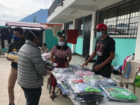 GHA distributing clothing in San Marcos