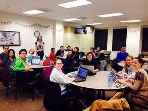 Hardworking CLS Leadership team reading apps!