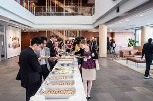 Delegates eating a catered meal after the session