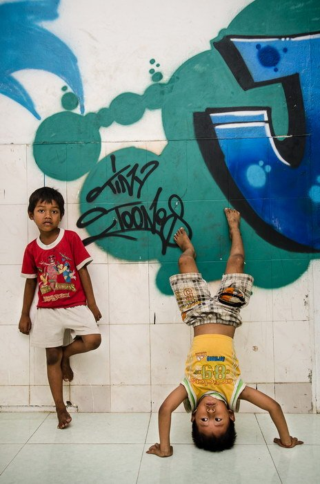 Tiny Toones kids in front of the new graffiti wall