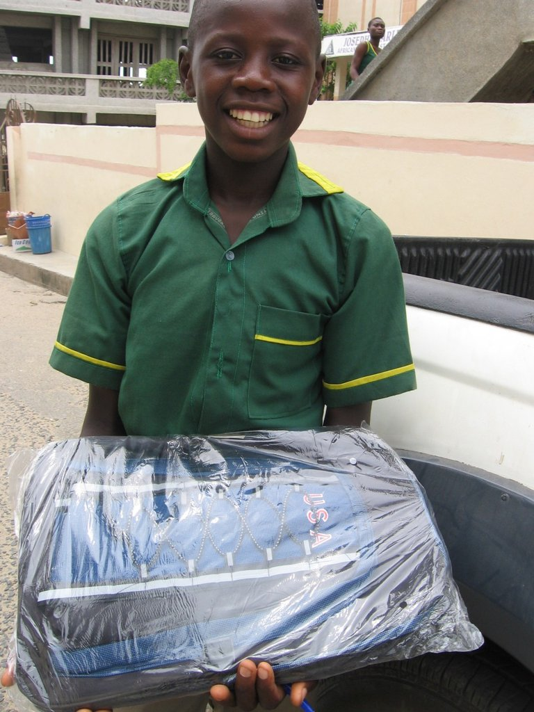 Student receiving new school bag from CH staff