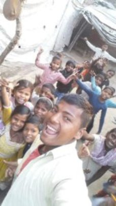 Rahul with children from his native village