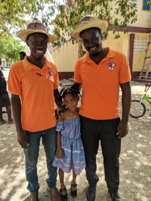 Teachers Raphael & Vladiny with a student