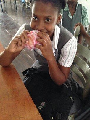 A student enjoying a peanut butter sandwich